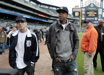 Music entertainers Eminem and Jay Z walk on the field of Comerica Park start of MLB baseball game between New York Yankees and Detroit Tigers