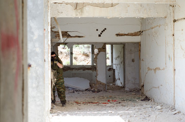 Soldier aim target abandoned building, airsoft