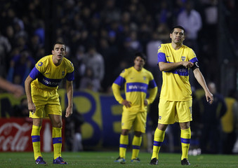 Boca Juniors' Riquelme, Somoza and Sosa react after Arsenal's second goal in their Argentine First Division soccer match in Buenos Aires