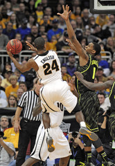 Missouri Tigers guard Kim English shoots against Baylor Bears forward Perry Jones III in the championship game of the NCAA men's Big 12 basketball tournament in Kansas City