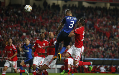 Monaco's Layvin Kurzawa heads the ball next to Benfica's Jardel during their Champions League Group C soccer match at Luz stadium in Lisbon