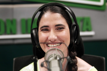 Cuba's best-known dissident, and blogger Yoani Sanchez laughs during an interview at a local radio station in Lima