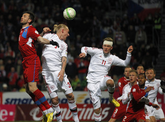 Czech Republic's Sivok, Denmark's Kjar and Cornelius jump for the ball during their 2014 World Cup qualifying soccer match in Olomouc