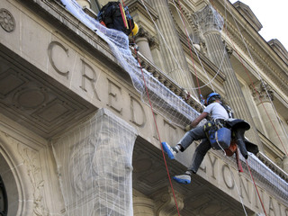 File picture shows maintenance workers carrying out renovation work at Paris headquarters of Credit Lyonnais bank