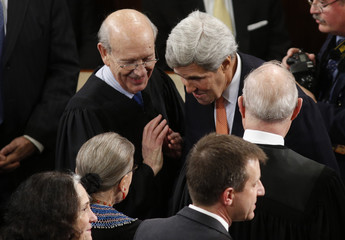 Supreme Court Associate Justices Breyer and Bader Ginsburg talk with Secretary of State Kerry as they arrive to watch President Obama's State of the Union address to a joint session of Congress in the U.S. Capitol in Washington