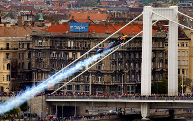 Besenyei of Hungary performs in his airplane during an air show in Budapest