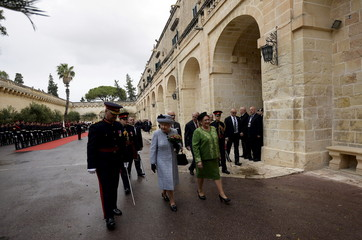 Britain's Queen Elizabeth walks with Maltese President Marie Louise Coleiro as she arrives at San Anton Palace in Attard, for the Commonwealth Heads of State Summit in Malta