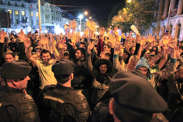 Demonstrators shout slogans during a protest as they are blocked by gendarmes from proceeding with their march on one of Bucharest's main boulevards