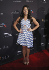 Actress Gina Rodriguez poses at the British Academy of Film and Television Arts (BAFTA) Los Angeles 2015 Awards season tea party in Beverly Hills