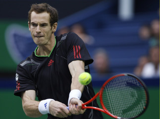 Murray of Britain returns the ball during the final match against Spain's Ferrer at the Shanghai Masters tennis tournament