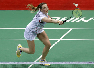 Denmark's Kjaersfeldt plays a shot against Malaysia's Tee during their women's singles match in the Uber Cup badminton championship in New Delhi