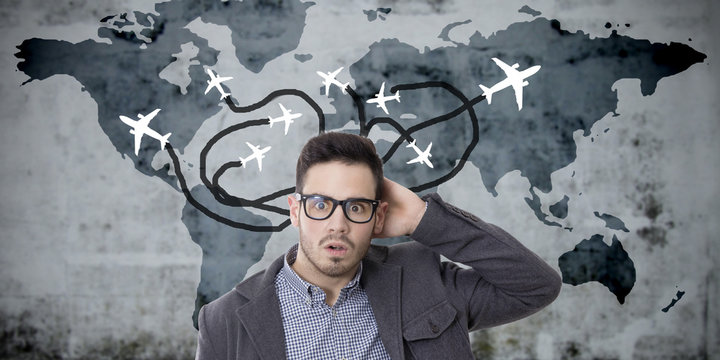 travel, man surprised with the map of travel and aircraft