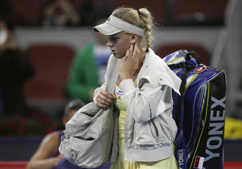Caroline Wozniacki of Denmark leaves the court in the China Open tennis tournament in Beijing