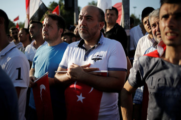 Supporters of Turkish President Tayyip Erdogan take part in a pro-government demonstration in Istanbul