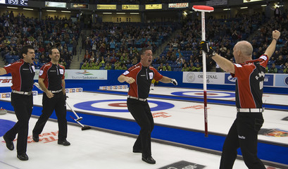 Team Ontario celebrates win during the gold medal game at the Canadian Men's Curling Championships in Saskatoon