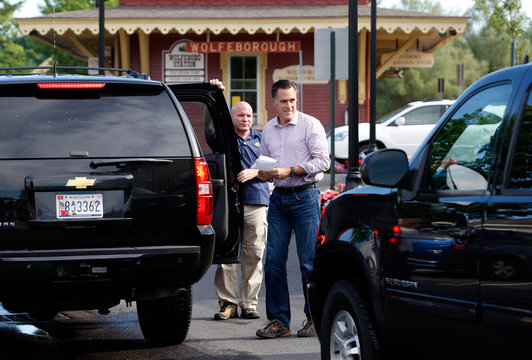 Republican presidential candidate Romney holds a shopping list in Wolfeboro