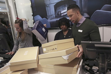 Staff members arrange shoe boxes at Macy's Herald Square store during the early opening of the Black Friday sales in the Manhattan borough of New York