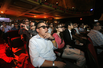 Attendees wear 3D glasses as they watch a presentation at the Sony Computer Entertainment America (SCEA) media briefing during the E3 expo in Los Angeles