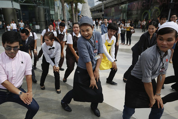 """Employees of a shopping mall dance """"Gangnam Style"""" before South Korean singer Psy arrives to greet his fans ahead of a concert in Bangkok"""