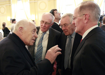 Former German CDU Secretary General Geissler talks to former Swiss Ministers Cotti, Koller and Deiss during the Swiss CVP party meeting in Luzern