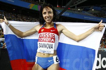 Savinova of Russia holds her national flag after winning the gold medal in the women's 800 metres final at the IAAF World Athletics Championships in Daegu