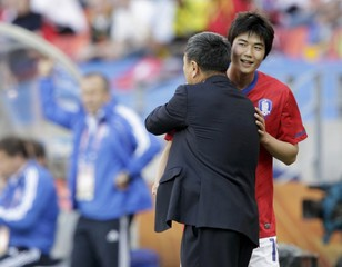 South Korea's Ki Sung-yong greets his coach Huh Jung-Moo after he was substituted during their 2010 World Cup Group B soccer match against Greece in Port Elizabeth