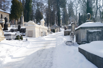 Cemetery with tombstones in winter