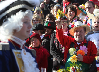 Prime minister of the German federal state of Rhineland-Palatinate Beck waves during the Rose Monday street carnival parade in Mainz