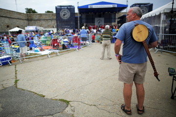 Audience member watches a performance at the Newport Folk Festival in Newport, Rhode Island