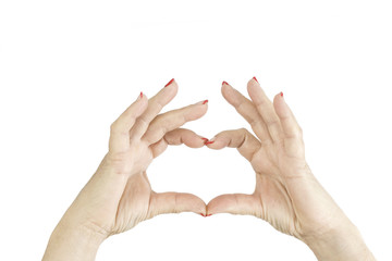 Woman hands showing heart symbol isolated on white background. Two hands in form of heart. Gesture love heart shape.