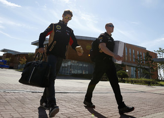Lotus F1 Formula One driver Grosjean of France arrives for the Korea F1 Grand Prix in Yeongam
