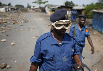 A policeman, wearing goggles, patrols the streets during a protest against President Pierre Nkurunziza's decision to run for a third term in Bujumbura