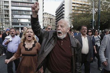 Employees in Greece's banking sector march to the parliament during a rally against planned changes in their pension fund in Athens