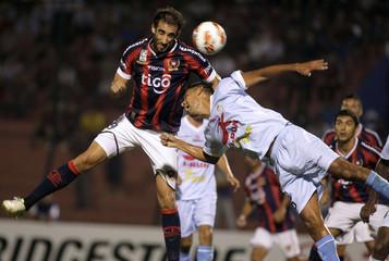 Bogado of Real Garcilaso fights for the ball with Nanni of Cerro Porteno during their Copa Libertadores soccer match in Asuncion