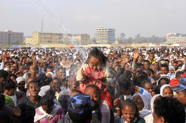 "An Ethiopian Orthodox girl is sprayed with baptism water during annual Epiphany celebrations called ""Timket"" in Addis Ababa"