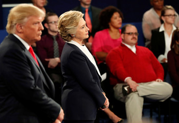 Ken Bone listens to a question along with Republican U.S. presidential nominee Trump and Democratic nominee Clinton during their presidential debate in St. Louis
