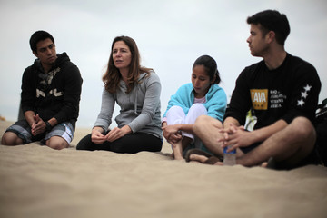 Occupational therapist Carly Rogers talks to military veterans at the surf therapy program she founded, in Manhattan Beach
