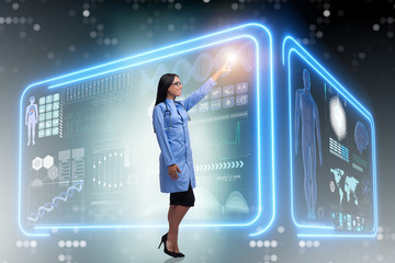 Woman doctor in futuristic medical concept