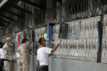 Security forces search for prohibited items during an operation at the Nonthaburi prison