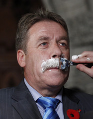 NDP Member of Parliament Peter Stoffer has his moustache shaved off to raise money for prostate cancer research in Ottawa