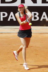 Sharapova of Russia returns the ball to Kerber of Germany at the Rome Masters tennis tournament