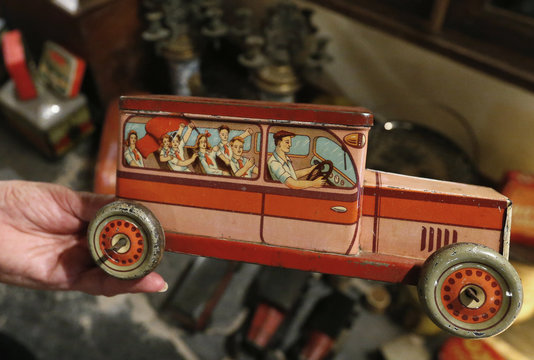 Dardenne shows a lithographed tin box dating from the 20th century and depicts people of the Communist Party in Slovenia riding a vehicle, at her house in Grand-Hallet