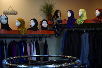 Headscarves decorate mannequin heads at Fayrouz Fashions, a boutique featuring traditional women's clothing from Middle East, in Dearborn, Michigan