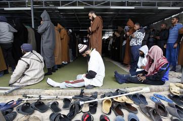 Prisoners pray at the Misrata Detention Centre close to Tripoli street in Misrata