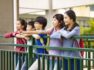 happy asian elementary schoolchildren