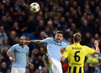 Manchester City's Garcia is challenged by Borussia Dortmund's Bender during their Champions League Group D soccer match in Manchester