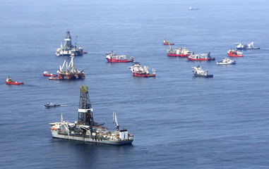 Drill ships and response vessels work in the Gulf of Mexico off the Louisiana coast line while attempting to drill relief wells  at the Deepwater Horizon Oil Spill wellhead