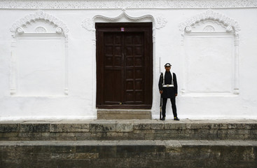 A member of the Nepalese Army stands guard at the courtyard of Bashantapur Durbar Square at a sacrificial ceremony during the Dashain festival in Kathmandu