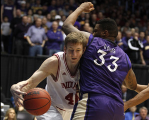 Indiana Hoosiers forward Cody Zeller (L) is pressured by James Madison Dukes forward Rayshawn Goins (33) during the first half of their second round NCAA basketball game in Dayton