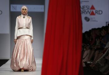 A model presents Muslim wear by Indonesian designer Norma Hauri during Jakarta Fashion Week